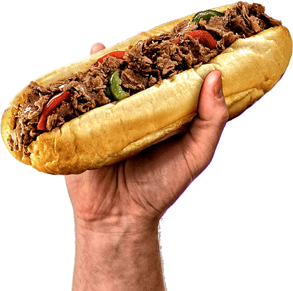hand holding a steak sandwich